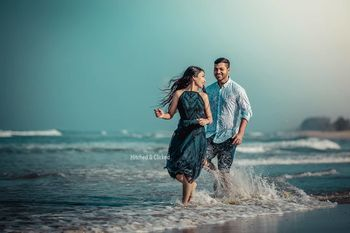 Photo of fun and playful pre wedding shot on the beach