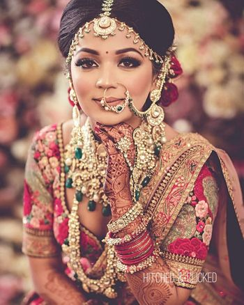 Photo of layered bridal jewellery with bridal nath and rani haar