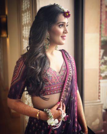 Photo of Mehendi bridal look in purple lehenga