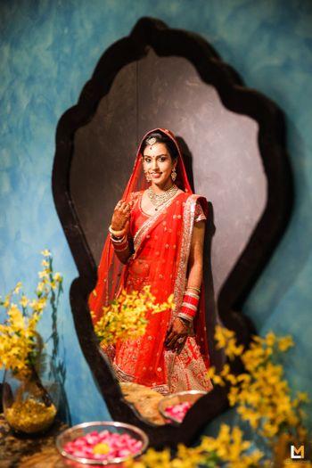 Bride Looking Through the Mirror Shot