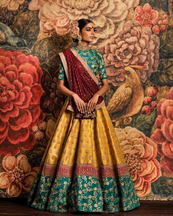 Sabyasachi bottle green and yellow bridal lehenga