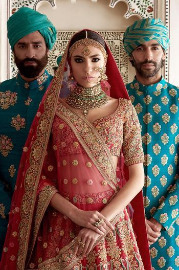 Wedding outfits for bride and groom by Sabyasachi