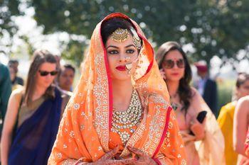 Bride Wearing Orange with Chunky Stone work Jewellery