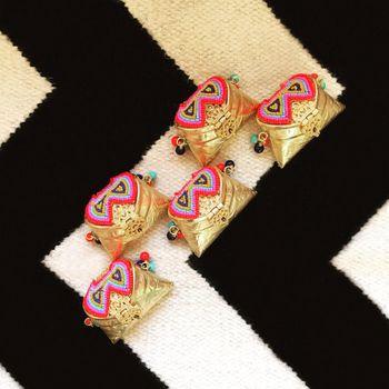 Photo of Mini clutches as mehendi favors