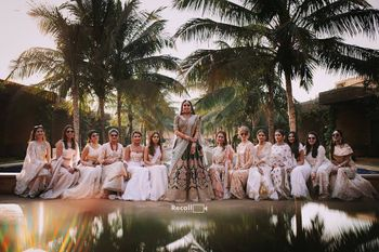 Photo of matching bride with bridesmaids shot