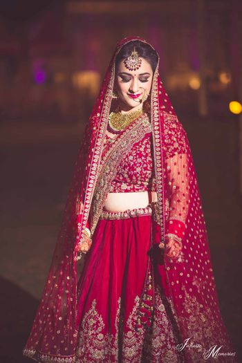 Photo of Deep red bridal lehenga with double dupatta draping style