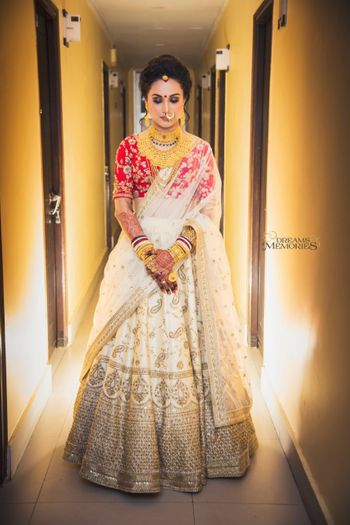 Off white bridal lehenga with red blouse