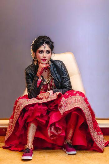 Offbeat modern bride in lehenga leather jacket and sneakers