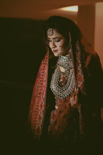 Silver jewellery with a red lehenga