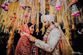 Candid shot of couple exchanging jaimalas