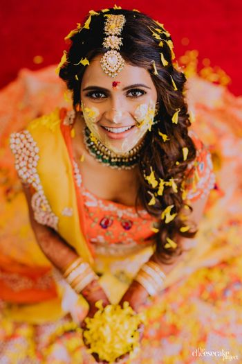 Bride wearing an ombre lehenga on haldi.