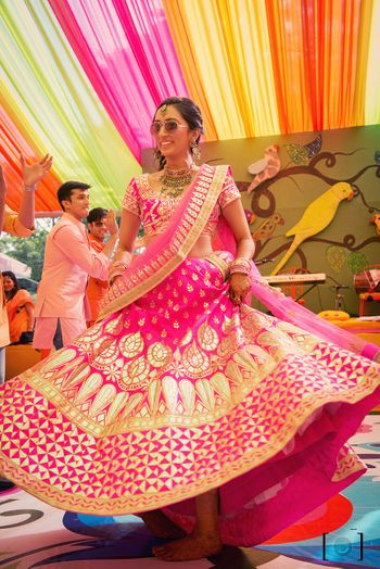 Twirling brides in fuschia pink
