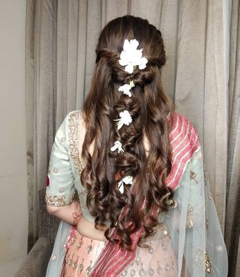 Half tie hairdo with bubble ponytail.
