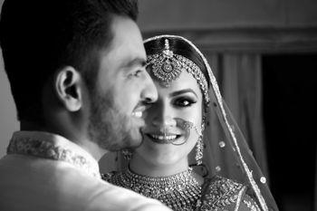 Photo of A beautiful monochrome couple shot.