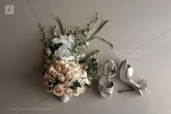 A unique bridal bouquet and a stunning pair of bridal shoes.