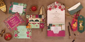 Photo of Modern Mughal theme destination wedding card
