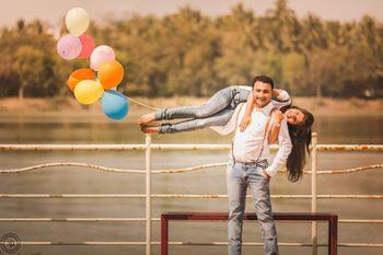 Couple Fun Pre Wedding Shoot with Balloons on Feet