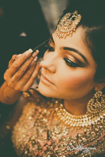 Golden bronze makeup for Indian bride