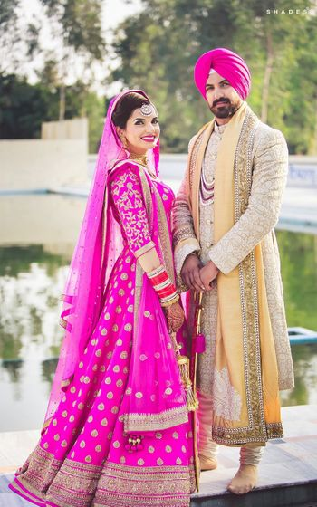 Sikh Bride in Pink Bridal Anarkali with Gold Motifs