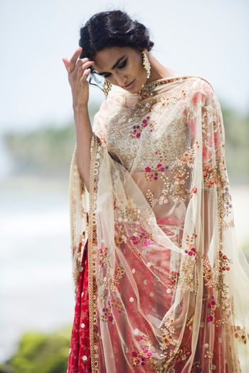 Photo of White ad red lehenga with mirror work