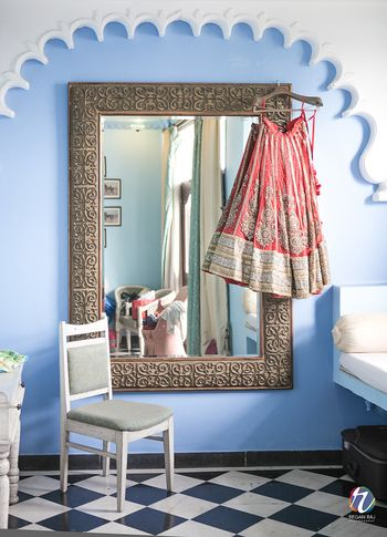 Red and Gold Lehenga on Hanger on Framed Vintage Mirror