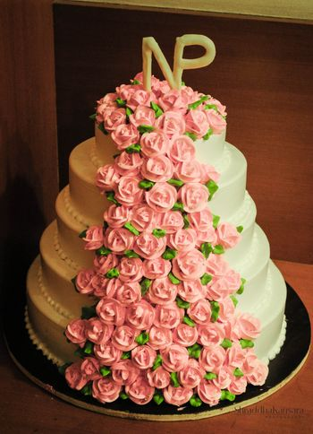 Photo of 5 Tiered White Cake with Pink Roses and Monograms