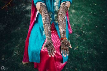 Intricate mehendi designs for bride