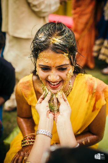 Photo of Happy bride haldi portrait in yellow