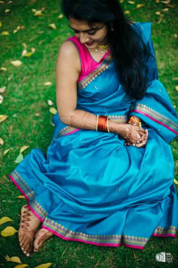 Simple silk saree in blue with minimal mehendi on the feet