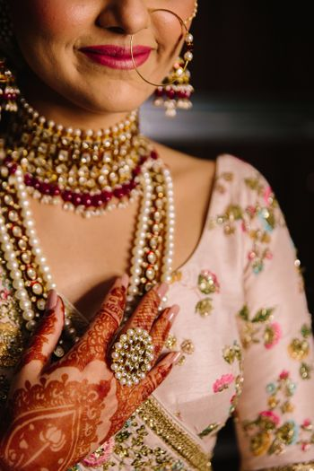 A bride flaunting her jewelry on her wedding day