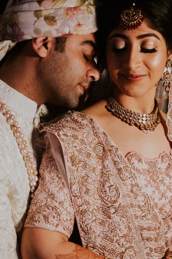 A romantic couple shot in beautiful outfits on their wedding.