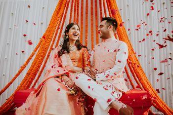 A happy couple shot amidst the rose petal shower.