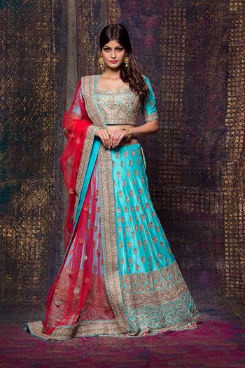 Aqua lehenga with gold motifs and red dupatta