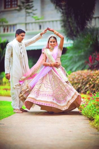 Bride Twirling in Day Wedding Light Pink Lehenga