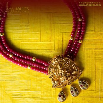 Gold temple jewellery with maroon beads