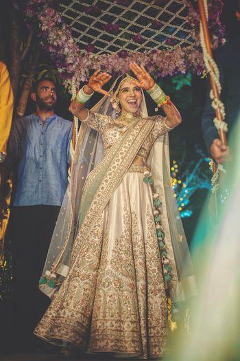 Dancing bride in ivory lehenga