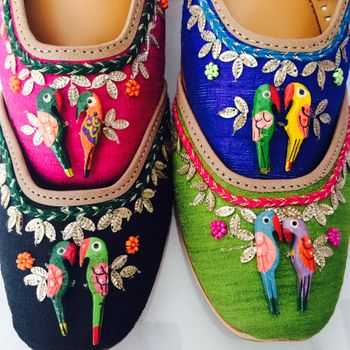 parrot detailing on flat shoes