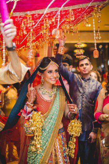 Happy Bride in Multicolour Lehenga Entering Wedding