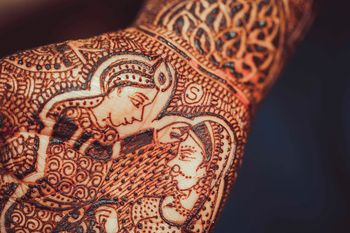 Bridal Mehendi Close Up with Bride and Groom Portrait
