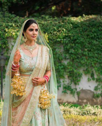 Mint and gold bridal lehenga offbeat hue