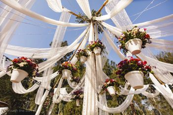 Hanging pot decor with white drapes
