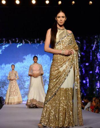 gold  and white sari