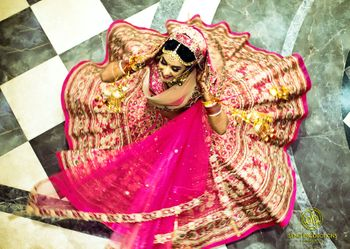 Twirling bride with flared out pink lehenga