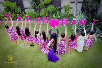 Bride with bridesmaids holding name props