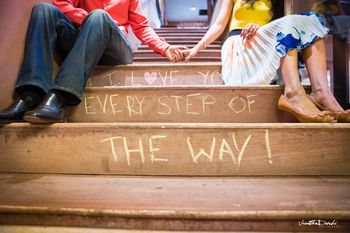 Pre wedding shoot idea with message scratched on stairs