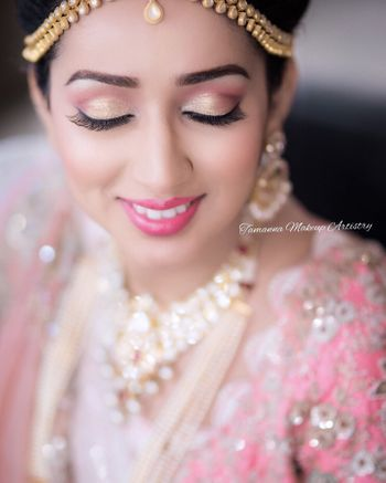 Pink and gold wedding makeup for Indian brides