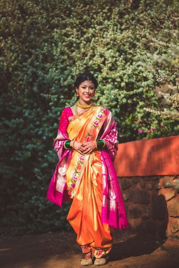 A beautiful Marathi bride in pink & yellow nauvari saree.