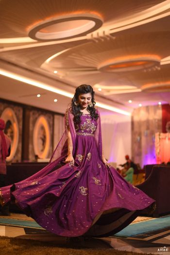Twirling bride in wine coloured gown