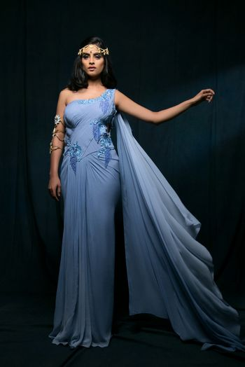 Photo of Powder Blue Cape One Shoulder Gown with Lace Work