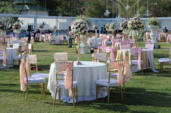 Photo of Pink and White Table Settings with Floral Centerpieces